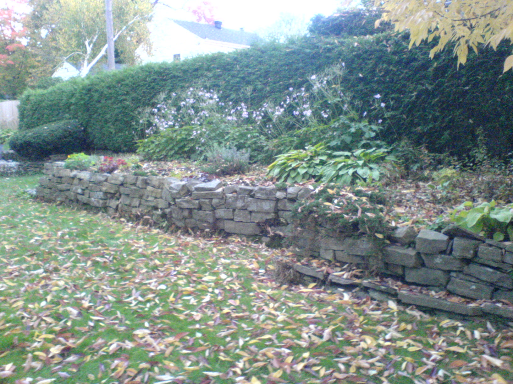 Rebuilding A Natural Stone Retaining Wall In Ottawa