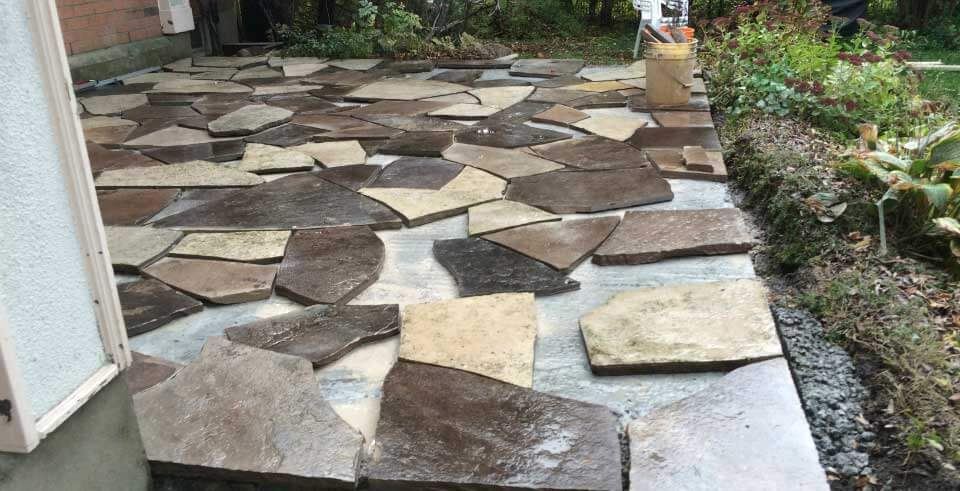 Rebuilding An Old Flagstone Patio With New Old Flagstone